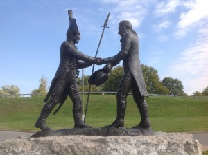 Montana artist Carol Grende sculpted lifelike figures of Meriwether Lewis and William Clark for the 2003 bicentennial celebration of the Lewis and Clark Expedition. The statue is at the entry to the Falls of the Ohio State Park.