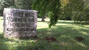 A stone marker bluntly states what happened at this spot along the banks of Fall Creek.