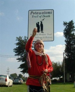 George Godfrey of Citizen Potawatomi Nation stands at the Trail of Death highway sign north of Rochester. Picture provided by Fulton County Historical Society.