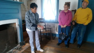 Docent Eileen Baker-Wall, great-great granddaughter of an escaped slave who made his home in Wayne County, leads visitors on a tour of the Coffin historic site.