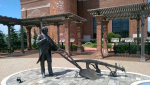 An outdoor exhibit in front of the Oliver smokestack tells the story of his chilled plow.