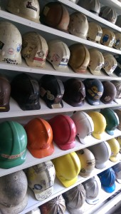 A display of protective helmets through the years.