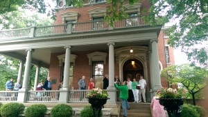 Visitors mingle outside the Italianate red brick home that Benjamin and Caroline Harrison built in 1875 and from which he conducted a front porch campaign in 1888.