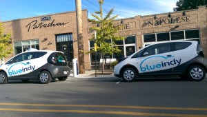 "In Indianapolis, BlueIndy was given prime retail parking spots to use as charging stations for its electric car sharing program. Citizens knew nothing about the program until the stations and ""no parking"" signs appeared on city streets. Photo by Andrea Neal."