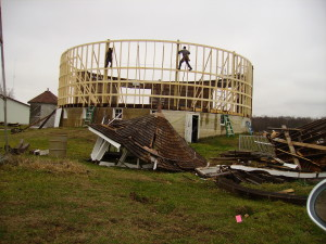 A crew works to restore the Fulton County Historical Society round barn, which was badly damaged last summer during a storm. Repairs should be completed by spring. Photo by Shirley Willard.