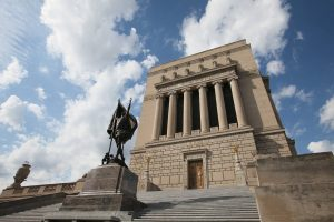 Built in the 1920s to honor World War I veterans, the War Memorial's neoclassical design features a pyramidal dome and Ionic columns. Photo by Indiana War Memorials Foundation.