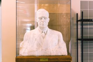 The Indiana University campus in Bloomington displays two sculptures of Paul V. McNutt: a bronze head-and-shoulders bust in the Memorial Union between the two doors to Alumni Hall and this marble one in the McNutt Residence Center. (Photos by Chasity Mottinger, Indiana University.)
