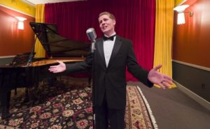 "An interpreter sings ""It's De-Lovely"" and other familiar tunes in the Cole Porter Room at the Indiana Historical Society. Photo courtesy of Indiana Historical Society."